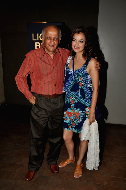 Actor Dia Mirza with filmmaker Mukesh Bhatt during the special screening of the movie Ek Villain in Mumbai on June 24, 2014. - Dia Mirza