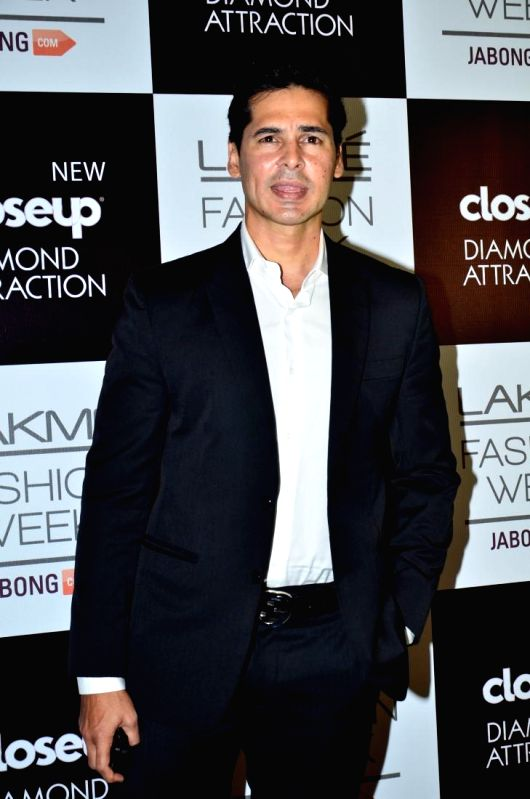 Actor Dino Morea during the Grand Finale day of Lakme Fashion Week (LFW) Winter/ Festive 2014, in Mumbai, on Aug. 24, 2014. - Dino Morea