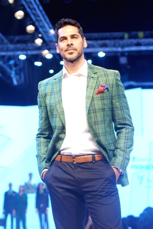 Actor Dino Morea walks the ramp during Van Heusen + GQ Fashion Nights 2017 in Mumbai on Nov 11, 2017. - Dino Morea