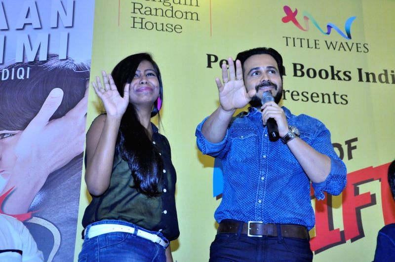 Actor Emraan Hashmi along with his wife Parveen Shahani and son Ayaan during the launch of book `The Kiss of Life: How a Superhero and My Son Defeated Cancer` in Mumbai, on May 30, 2016. The ... - Emraan Hashmi
