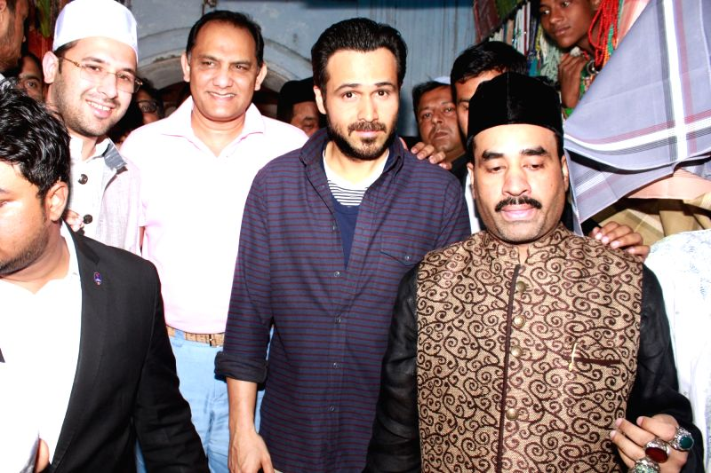 """Actor Emraan Hashmi and former India cricketer Mohammad Azharuddin pay obeisance at Nizamuddin Dargah ahead of the release of their upcoming film """"Azhar"""" in New Delhi, on May 9, ... - Emraan Hashmi and Azharuddin"""
