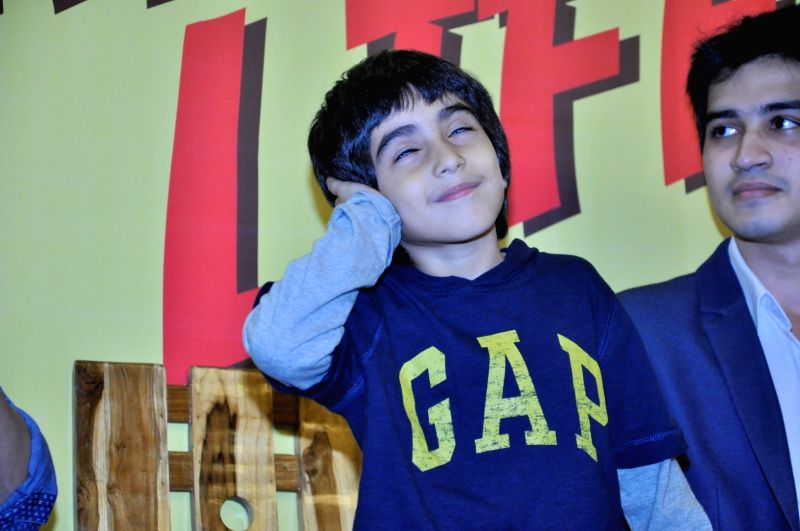 Actor Emraan Hashmi`s son Ayaan during the launch of book `The Kiss of Life: How a Superhero and My Son Defeated Cancer` in Mumbai, on May 30, 2016. The book authored by Emraan Hashmi and ... - Emraan Hashm