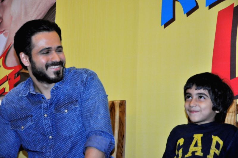 Actor Emraan Hashmi with his son Ayaan during the launch of book `The Kiss of Life: How a Superhero and My Son Defeated Cancer` in Mumbai, on May 30, 2016. The book authored by Emraan Hashmi ... - Emraan Hashmi