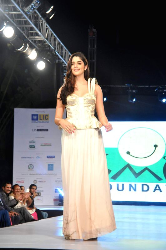 Actor Evelyn Sharma walks on the ramp during the 5th edition of charity fashion show, Ramp for Champs organised by Smile Foundation, in Mumbai, on April 19, 2014. - Evelyn Sharma
