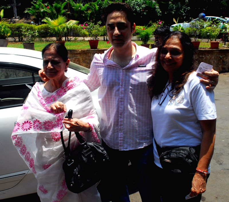 Actor Faisal Khan and his family members arrive to cast their votes at a polling booth during the sixth phase of 2014 Lok Sabha Polls in Mumbai on April 24, 2014.