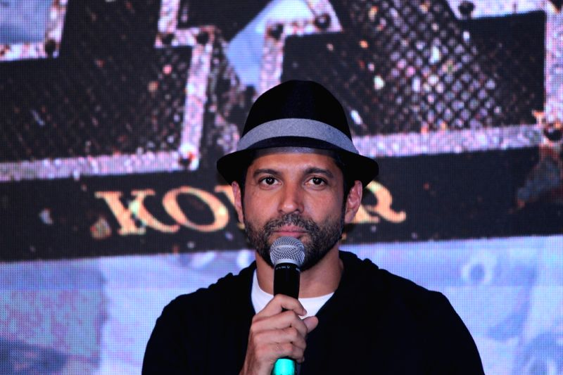 """Actor Farhan Akhtar addresses at the trailer launch of his upcoming film """"K.G.F"""" in Mumbai(Image Source: IANS)"""