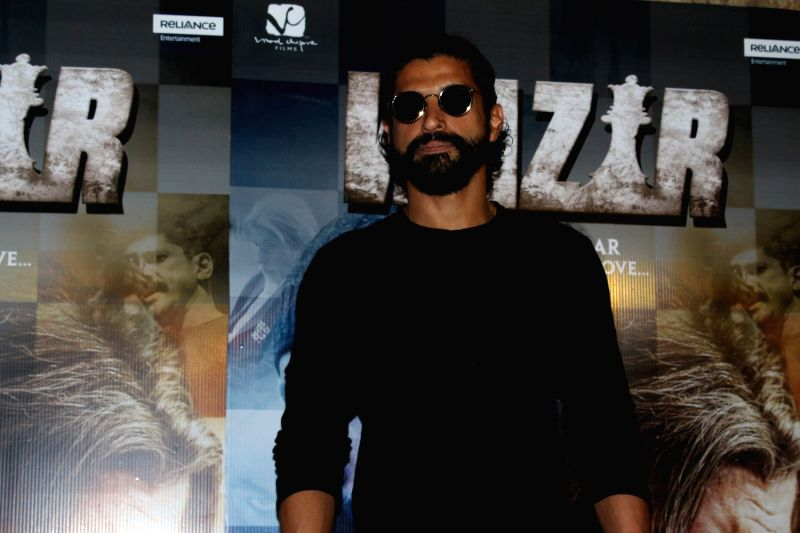 Actor Farhan Akhtar arrives to watch the first song Tere Bin from film Wazir in Mumbai on Dec 4, 2015. - Farhan Akhtar