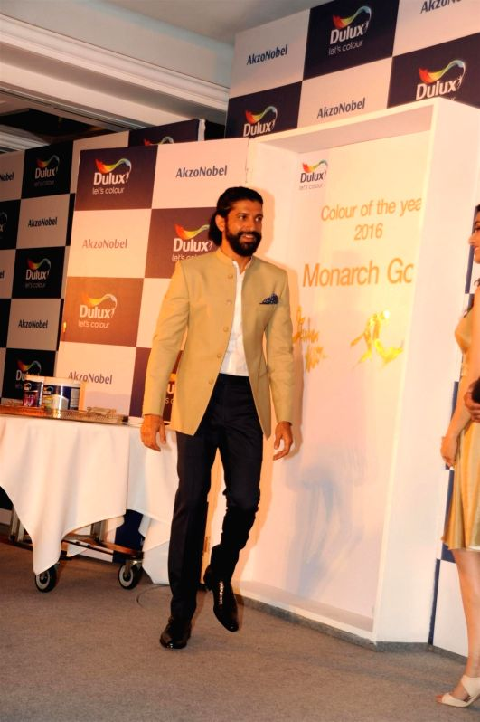 Actor Farhan Akhtar during the unveiling of AkzoNobel`s Monarch Gold as Colour of the Year 2016 in a Colour Walk in Mumbai on Dec. 2, 2015.