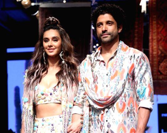 Actor-filmmaker Farhan Akhtar and singer Shibani Dandekar showcase creations Payal Singhal at the Lakme Fashion Week Winter/Festive 2019.