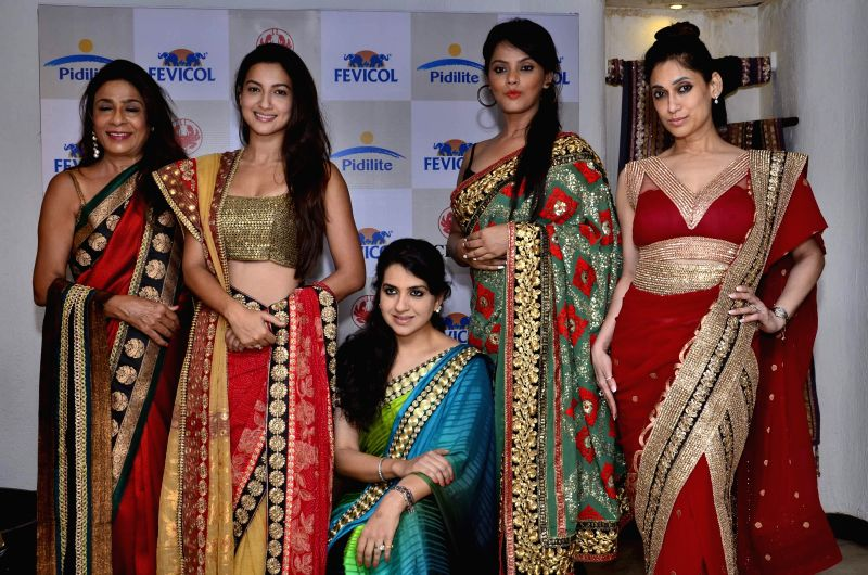Actor Gauhar Khan along with others during the fashion preview of Shaina NC`s 9th Annual 'Caring with Style' Fashion show in Mumbai, on May 8, 2014.