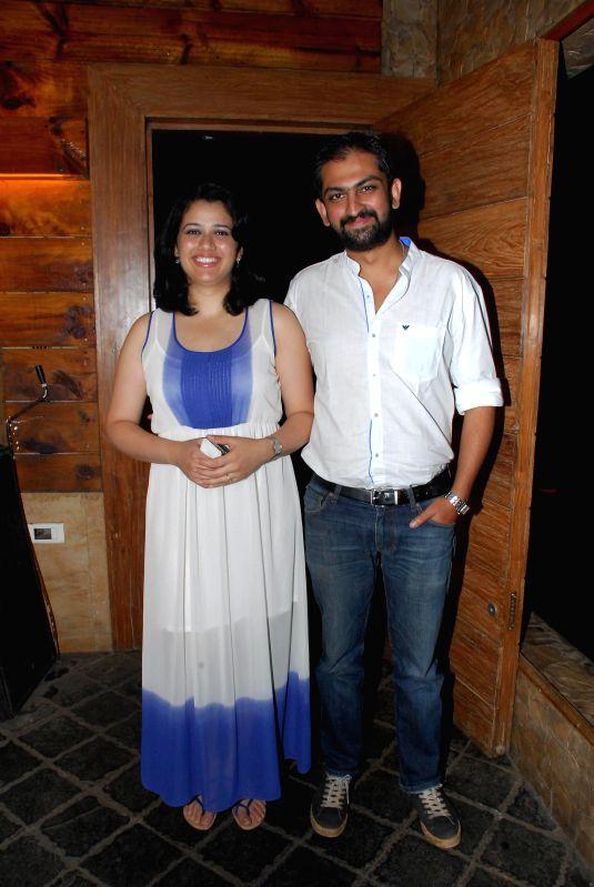 Actor Girija Oak and filmmaker Suhrud Godbole during the success party of Marathi film Poshter Boyz in Mumbai, on Aug 19, 2014. - Girija Oak