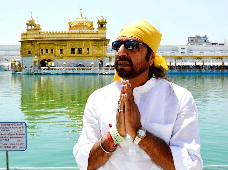 Actor Girja Shankar pays obeisance at the Golden Temple in Amritsar on April 28, 2014.