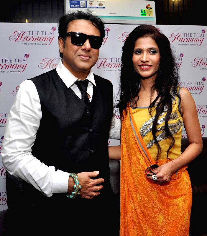 Actor Govinda and Mrs India International 2011 Richa Sharma during launch of Thai spa in Kolkata on July 4, 2014. - Richa Sharma