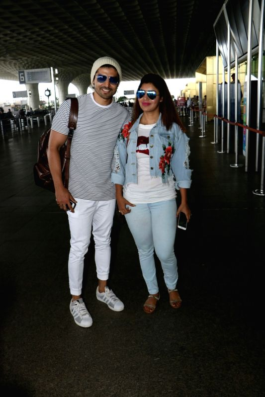 Actor Gurmeet Choudhary along with his wife Debina Bonnerjee spotted at Chhatrapati Shivaji Maharaj International airport in Mumbai. - Gurmeet Choudhary and Debina Bonnerjee