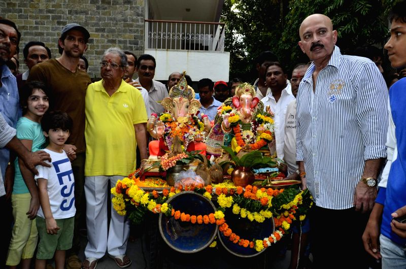 Actor Hrithik Roshan with father filmmaker Rakesh Roshan and grand father J. Om Prakash durig the immersion of an idol of the elephant-headed Hindu god Lord Ganesh after one and half day in Mumbai on - Hrithik Roshan and Rakesh Roshan