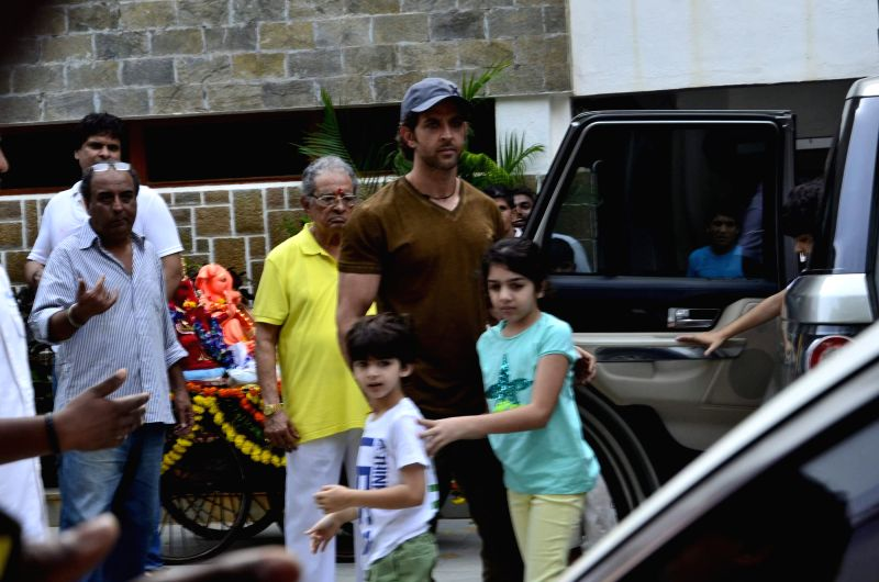 Actor Hrithik Roshan with grand father and fimmaker J. Om Prakash and his children durig the immersion of an idol of the elephant-headed Hindu god Lord Ganesh after one and half day in Mumbai on ... - Hrithik Roshan