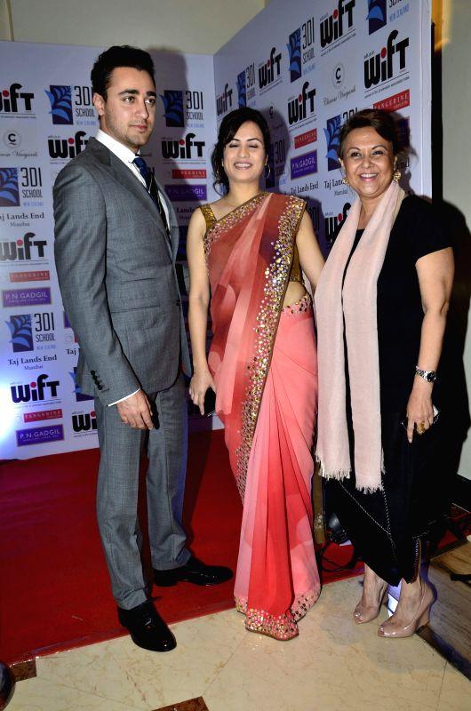 Actor Imran Khan, Petrina D`Rozario, founder President, WIFT and Vandana Malik during the WIFT 61st National Women achievers award ceremony in Mumbai on May 09, 2014. - Imran Khan and Malik