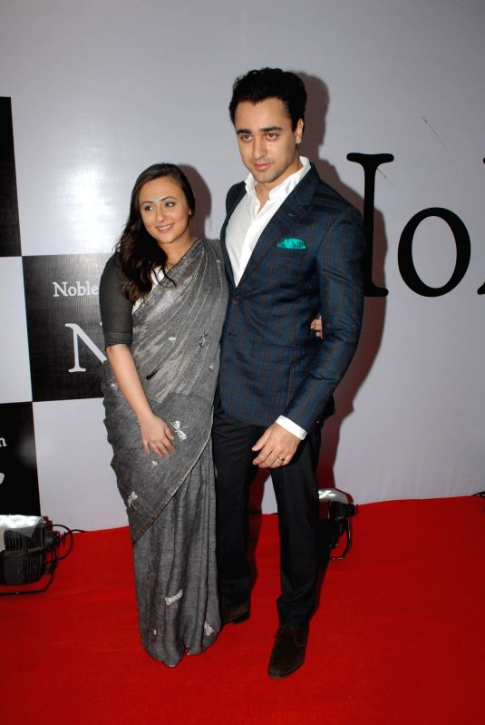 Actor Imran Khan with wife Avantika Malik during the launch of the brand Noble Faith in Mumbai on Aug 14, 2014. - Imran Khan and Malik