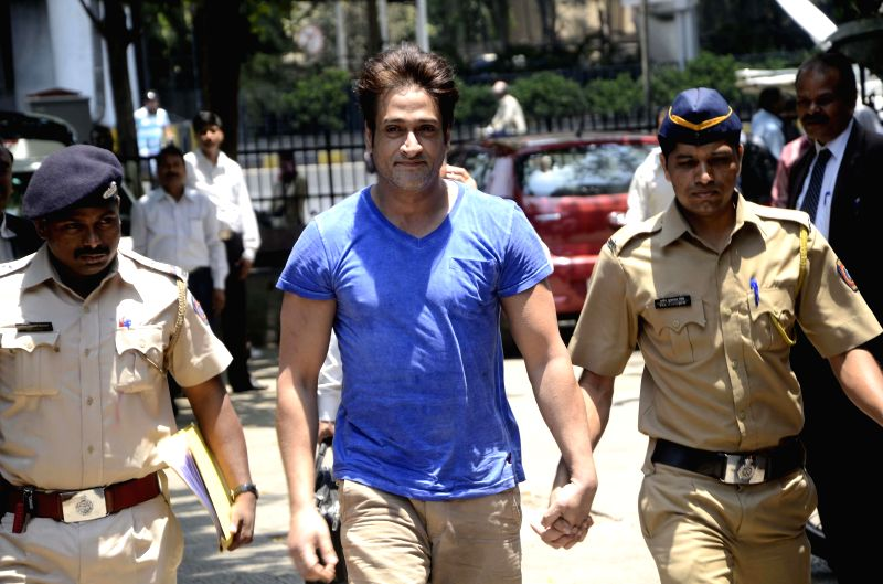Actor Inder Kumar arrested by Mumbai Police for allegedly raping a 23-year-old model at his house being produced at a Bandra court in Mumbai on April 26, 2014.