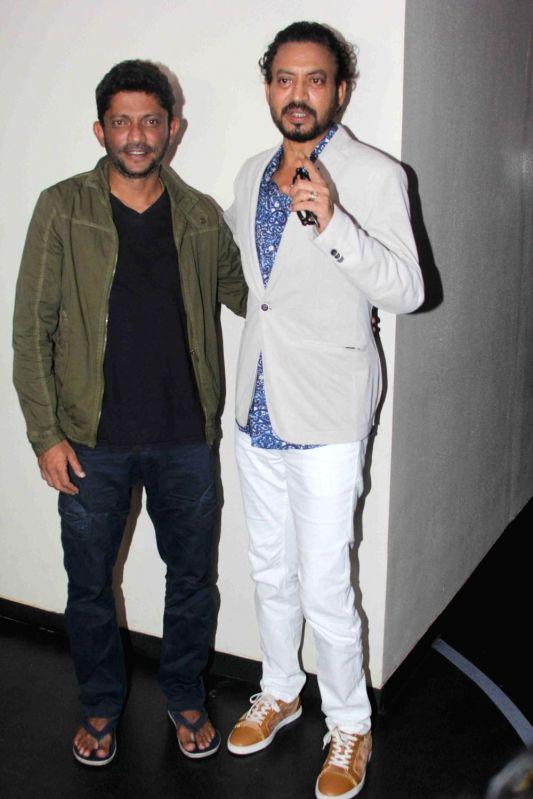 Actor Irrfan Khan and filmmaker Nishikant Kamat during the special screening of film Madaari, in Mumbai, on July 17, 2016. - Irrfan Khan