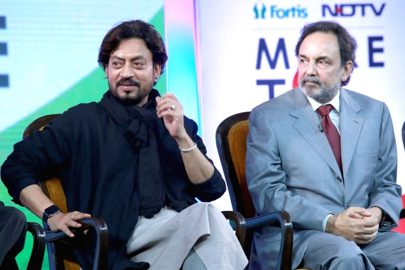 Actor Irrfan Khan and NDTV Group Co-Chairperson Founder & Executive Dr. Prannoy Roy during the launch of the 'More To Give' campaign on the occasion of Kargil Diwas in New Delhi on ... - Irrfan Khan and Prannoy Roy