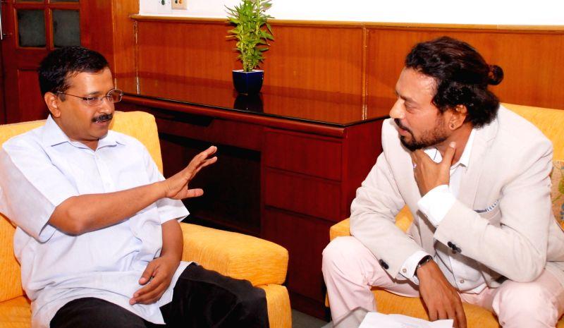 Actor Irrfan Khan calls on the Delhi Chief Minister Arvind Kejriwal at the Delhi Secretariat in New Delhi on July 19, 2016. - Irrfan Khan and Arvind Kejriwal