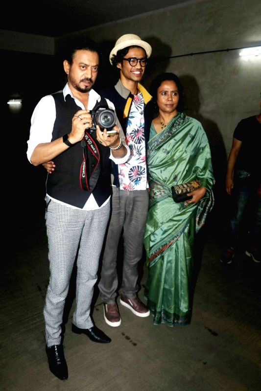 Actor Irrfan Khan with wife Sutapa Sikdar and son Babil during the screening of film Madaari in Mumbai, on July 21, 2016. - Irrfan Khan