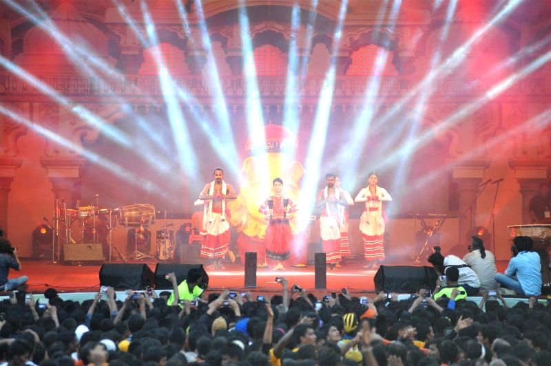 Actor Isha Sharvani performs during Shri Sankalp Pratishthan`s Dahi Handi celebrations in Mumbai on Aug. 18, 2014. - Isha Sharvani