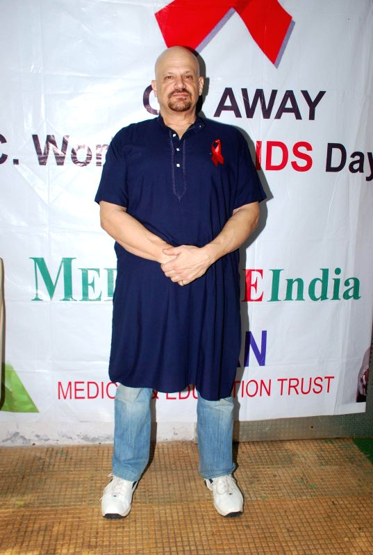 Actor J. Brandon Hill for AIDS awareness while celebrating World AIDS Day in Mumbai on Dec 1, 2014. - J. Brandon Hill