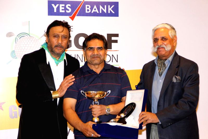 Actor Jackie Shroff and others during the 'Invitational Championship' prize distribution ceremony organised by Yes Bank Golf Foundation in New Delhi on May 4, 2014. - Jackie Shroff