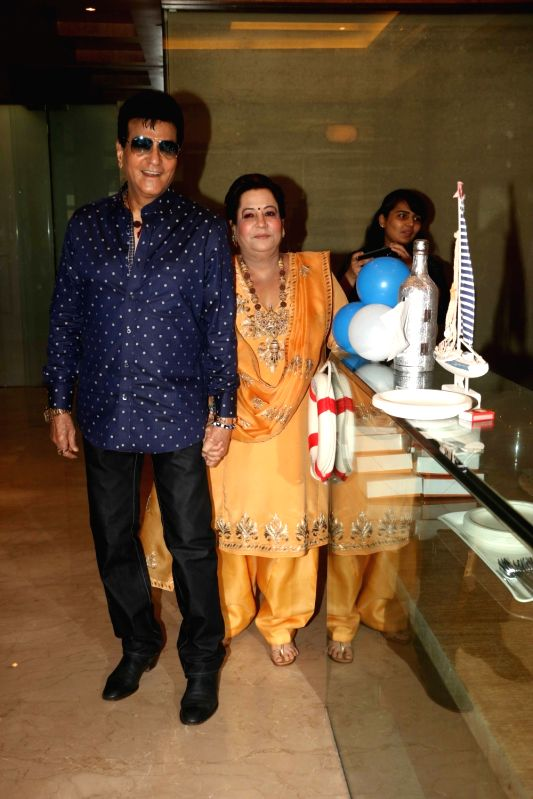 Actor Jeetendra with his wife Shobha Kapoor during Tussar Kapoor son Laksshay`s first birthday party in Mumbai on June 1, 2017. - Jeetendra, Shobha Kapoor and Tussar Kapoor