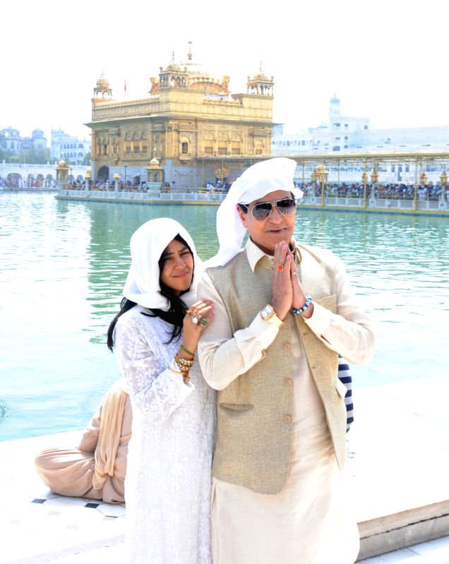 Actor Jitender and his daughter and television producer Ekta Kapoor pay obeisance at the Golden Temple in Amritsar, on March 20, 2015.