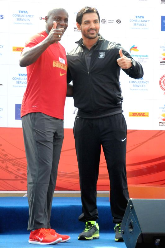 Actor John Abraham and athlete Carl Lewis during TCS World 10K Bangalore at Kanteerava Stadium in Bangalore on May 18, 2014. - John Abraham