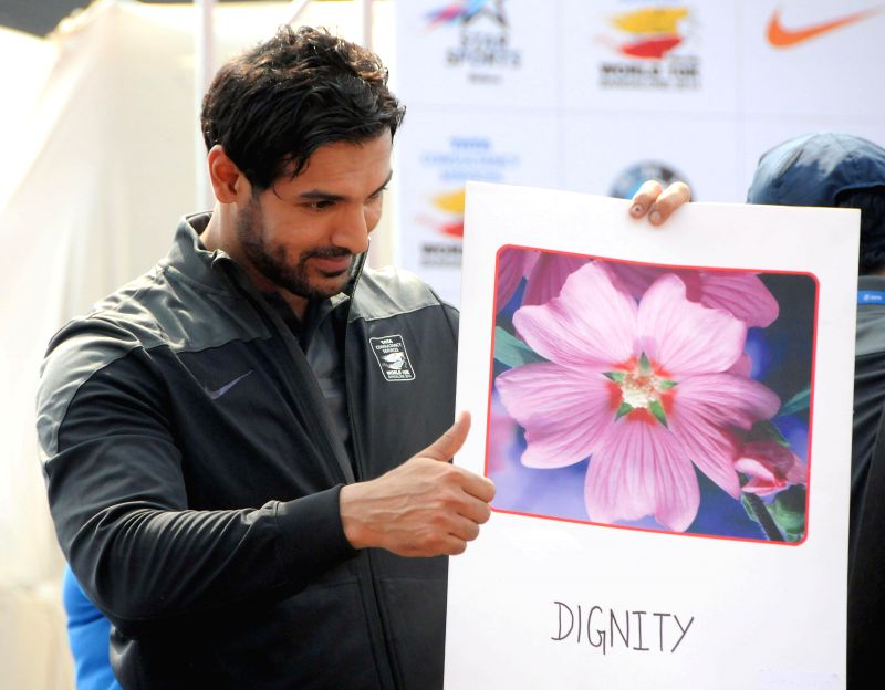 Actor John Abraham during TCS World 10K Bangalore at Kanteerava Stadium in Bangalore on May 18, 2014. - John Abraham