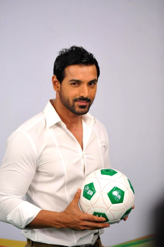 Actor John Abraham during the Castrol Activ Cling on to Football campaign in Mumbai on July 5, 2014. - John Abraham