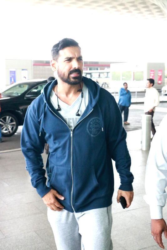 Actor John Abraham spotted at airport. - John Abraham