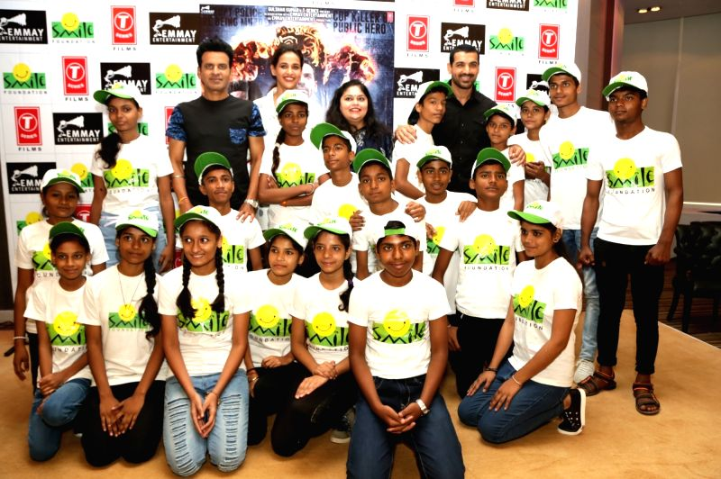 Actor John Abraham with childrens of Smile Foundation NGO in New Delhi on Aug 10, 2018. - John Abraham