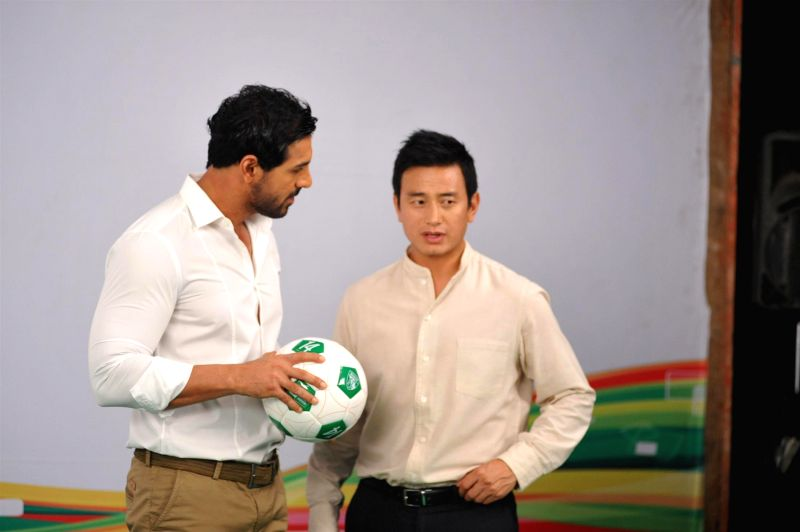 Actor John Abraham with former Indian football captain Baichung Bhutia during the Castrol Activ Cling on to Football campaign in Mumbai on July 5, 2014. - John Abraham