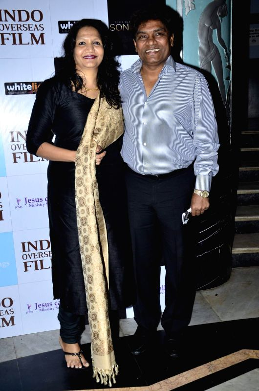 Actor Johnny Lever with his wife Sujatha Lever during the premiere of Hollywood film Son of God, in Mumbai on Monday, April 14, 2014. - Johnny Lever