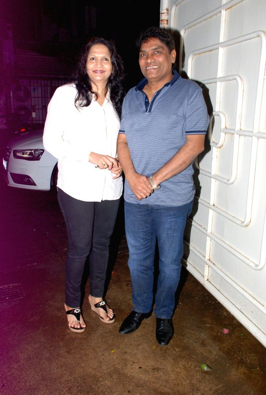 Actor Johnny Lever with his wife Sujatha Lever during the screening of the film Entertainment in Mumbai on Aug 6, 2014. - Johnny Lever