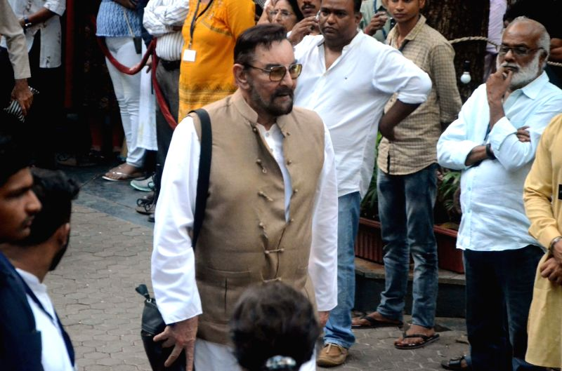 Actor Kabir Bedi arrives to attend Late actor Shashi Kapoor's condolence meeting in Mumbai on Dec 7, 2017. - Kabir Bedi and Shashi Kapoor
