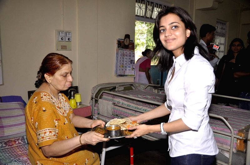 Actor Kajal Agarwal celebrate her birthday with the old aged people at Anand Niketan NGO in Mumbai on Thursday, June 19, 2014. The diva was seen serving food to the people in the NGO.