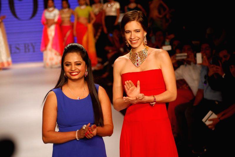 Actor Kalki Koechlin display jewellery by Preeti during the India International Jewellery Week (IIJW) in Mumbai, on July 14, 2014.