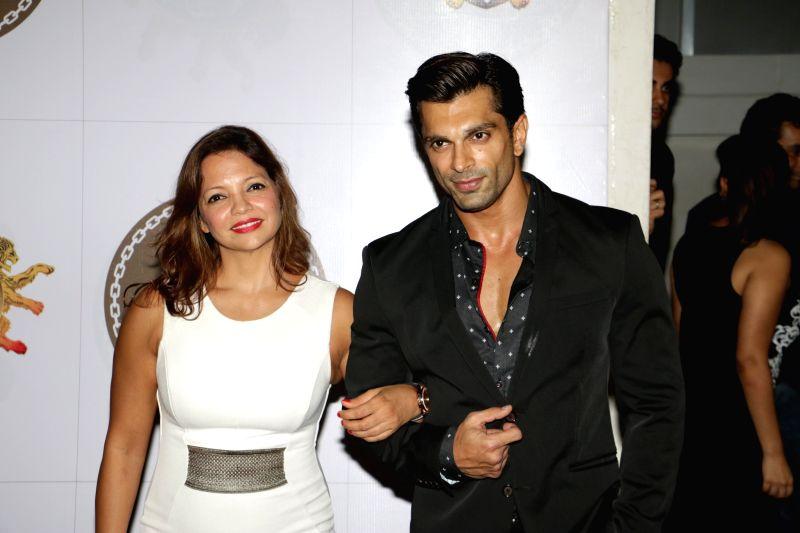 Actor Karan Singh with fitness expert Deanne Panday during 24K Gold Party in Mumbai, on Aug 13, 2015. - Karan Singh