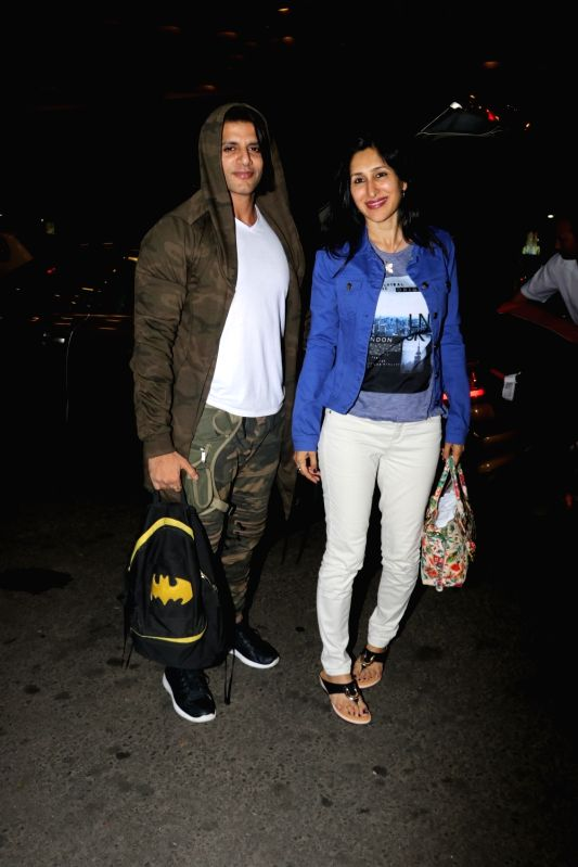 Actor Karanvir Bohra along with his wife Teejay Sidhu seen at Chhatrapati Shivaji Maharaj International airport in Mumbai on Dec 7, 2017. - Karanvir Bohra