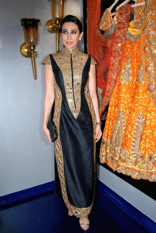 Actor Karishma Kapoor during the store opening of designer Mayyur Girotra in Mumbai, on April 18, 2014. - Karishma Kapoor