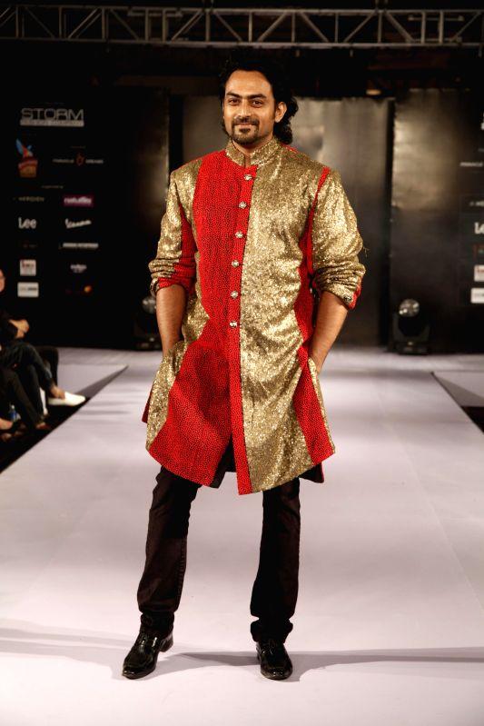 Actor Karthik Jayaram walks the ramp showcasing creations of fashion designer Sanjana Jon during Kingfisher Ultra Style Week Bangalore 2014 on July 27, 2014. - Karthik Jayaram