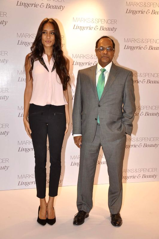 Actor Lisa Haydon and Venu Nair, Managing Director of Marks and Spencer Reliance India, during the launch of Marks & Spencer's first standalone lingerie & beauty store in Mumbai, on May 7, ...