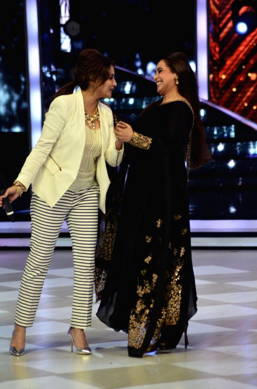 Actor Madhuri dixit and Rani Mukherj on the sets of Jhalak Dikhhla Jaa 7 during the promotion of film Mardaani in Mumbai on July 22, 2014. (Photo : IANS) - Madhuri
