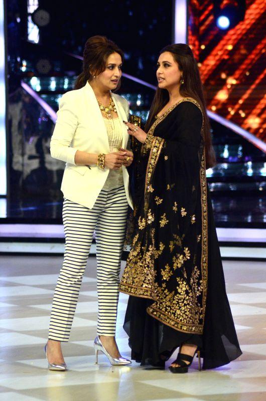 Actor Madhuri dixit and Rani Mukherji on the sets of Jhalak Dikhhla Jaa 7 during the promotion of film Mardaani in Mumbai on July 22, 2014. (Photo : IANS) - Madhuri